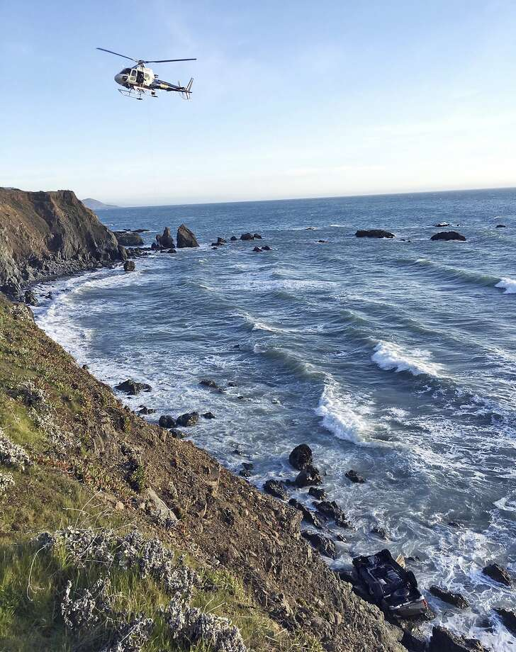 A helicopter on Tuesday hovers over steep coastal cliffs near Mendocino, Calif., where a vehicle — visible at lower right — plunged about 100 feet off a cliff along Highway 1, killing all five passengers. The California Highway Patrol identified the victims Tuesday as two women from West Linn, Ore., and three children. On Wednesday, three additional children were reported missing. Photo: California Highway Patrol / Associated Press