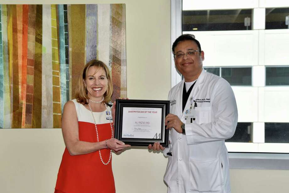"Physician of the Year – Ali Rizvi, MD, interventional cardiologist, (Right) has been named the ""2018 Physician of the Year"" at Houston Methodist The Woodlands Hospital, and was recently honored by Debbie Sukin, CEO of Houston Methodist The Woodlands Hospital."