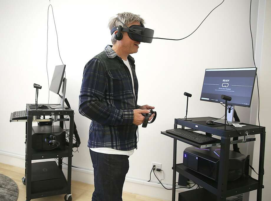 CEO Philip Rosedale shows off one of High Fidelity's 20 virtual reality stations in its Howard Street studio. Photo: Photos By Liz Hafalia / The Chronicle