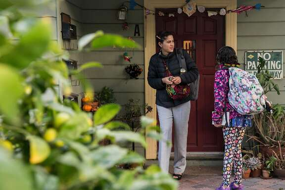 Lorena Melgarejo leaves her home to take her daughter to school Friday, March 23, 2018 in San Francisco, Calif.