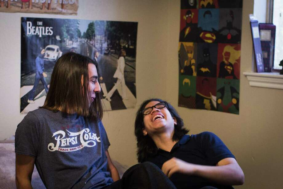 Kristopher Bibaud, left, 18, and Adiel Fandino, right, 19, who are housemates share some laughs in 2014. A year earlier, to help those teens aging out of the system better adjust, the Texas Department of Family and Protective services started a program centered around supervised independent living. Unfortunately, not all foster children who age out of the system fare well — a quarter end up incarcerated. Photo: Marie D. De Jesus /Houston Chronicle / Â 2014 Houston Chronicle