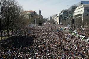 """Looking west, people fill Pennsylvania Avenue during the """"March for Our Lives"""" rally in support of gun control, Saturday in Washington D.C. Such marches occurred nationally."""