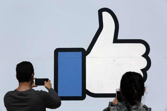 Vistors stop for photos at the famous Facebook sign in front of their headquarters at 1 Hacker way in Menlo Park, Calif. as seen on Tues. Mar. 27, 2018.