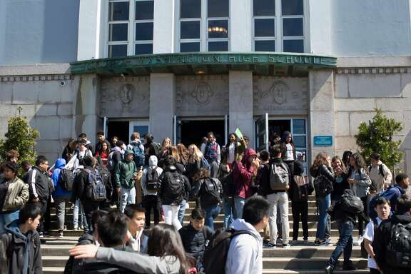Washington High School students leave the school Thursday afternoon March 22, 2018 at the end of the day in San Francisco, Calif.  After a student at Washington High School  received straight Fs for all four years, there are questions about why he was permitted to fail for so long.
