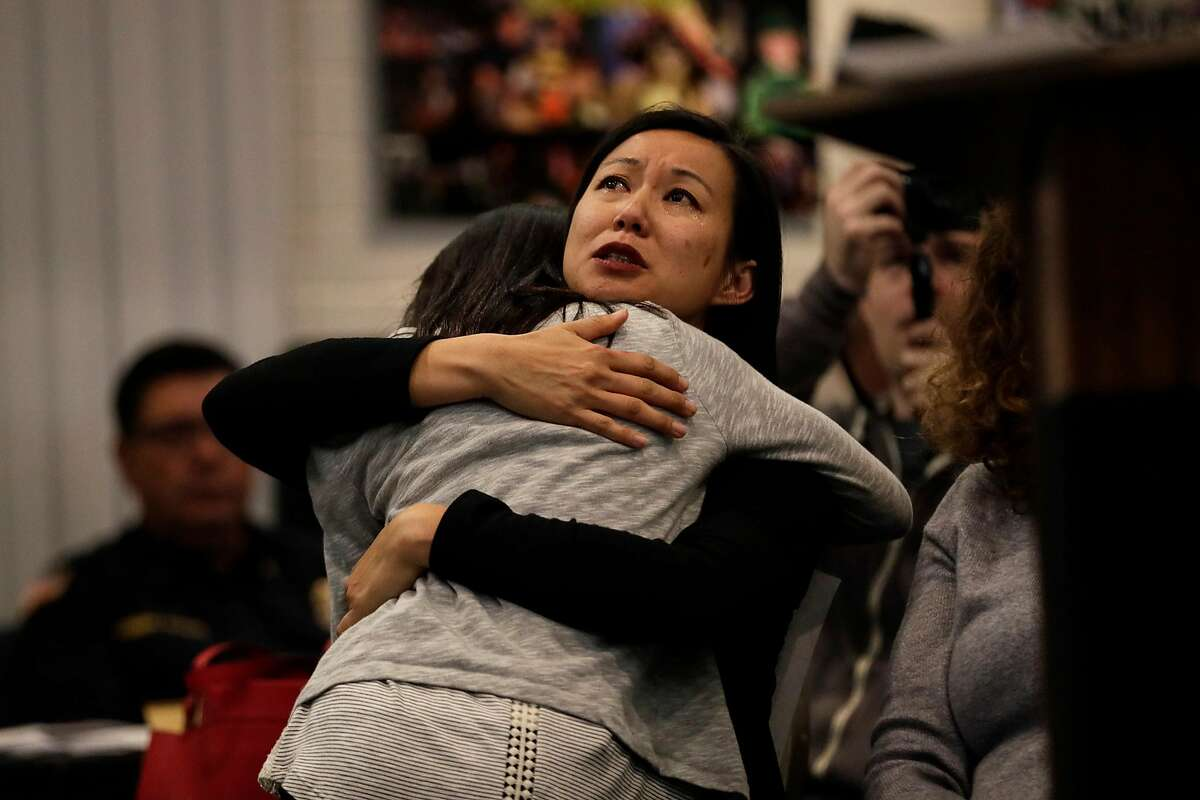 Cathery Chen embraces her daughter, Emy, after the 10 year-old spoke at the Los Alamitos City Council meeting, speaking out against its efforts to oppose California's sanctuary state law Monday, March 19, 2018 in Los Alamitos, Calif. (Robert Gauthier/Los Angeles Times/TNS)
