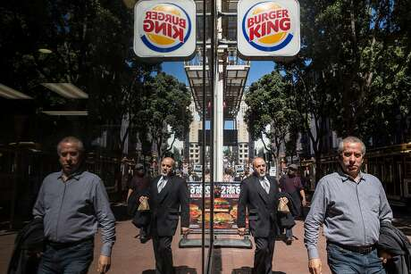 Burger King on Powell Street in S.F. with its reflection. Photo: Jessica Christian / The Chronicle 2018