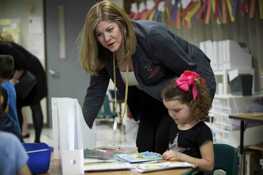 Martha Salazar-Zamora, Tomball ISD superintendent, looks over Reagan Howard's shoulder during her kindergarten class at Willow Creek Elementary School on Wednesday, March 21, 2018, in Tomball. ( Brett Coomer / Houston Chronicle ) Photo: Brett Coomer, Staff / Houston Chronicle / © 2018 Houston Chronicle