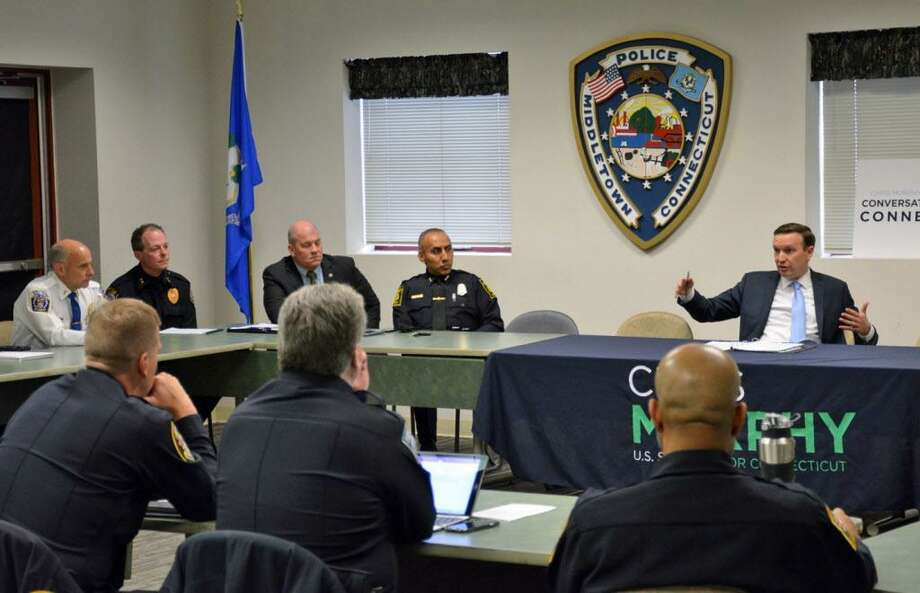 U.S. Sen. Chris Murphy met with police chiefs from across the state Tuesday evening at Middletown police headquarters to get feedback on how he can better support local law enforcement in Congress. As a member of the Appropriations Committee, Murphy helped secure $275.5 million in Community Oriented Policing Services grants, which many Connecticut communities use to help hire and train new police officers, in the latest federal budget bill. Photo: Laura Maloney Photo