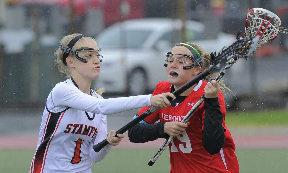 Stamford';s Kelly Jagodzinski, left, is a sneiro cpatain for the Black Knights. Photo: Matthew Brown / Hearst Connecticut Media / Stamford Advocate