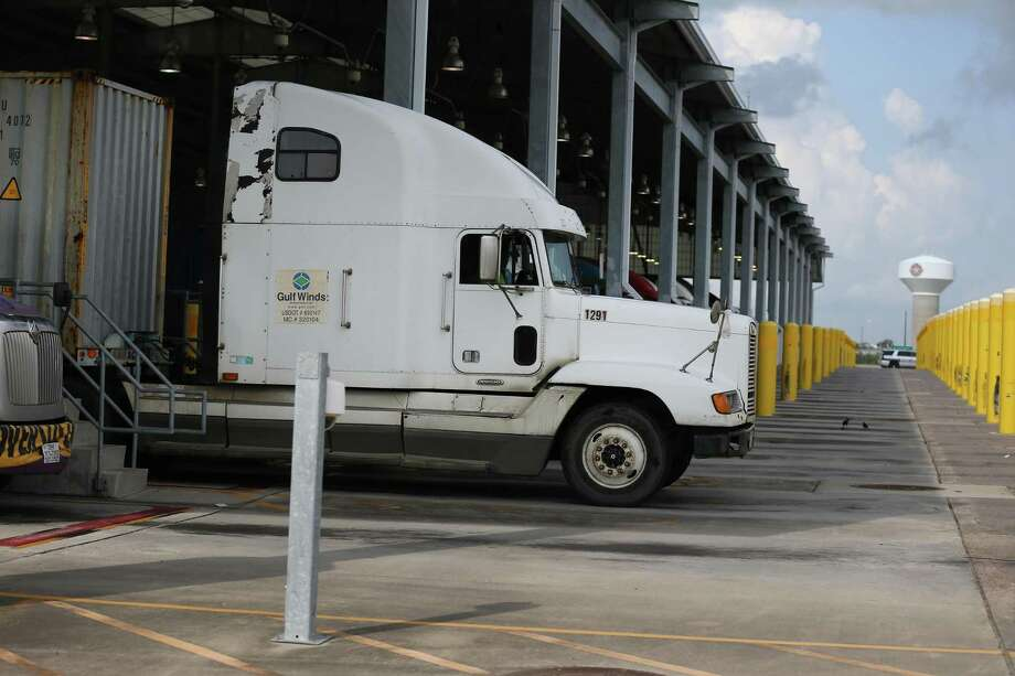 Trucks enter the gates of the Bayport Container Terminal on Sept. 21, 2017, in Seabrook. Photo: Steve Gonzales, Houston Chronicle / Houston Chronicle / © 2017 Houston Chronicle