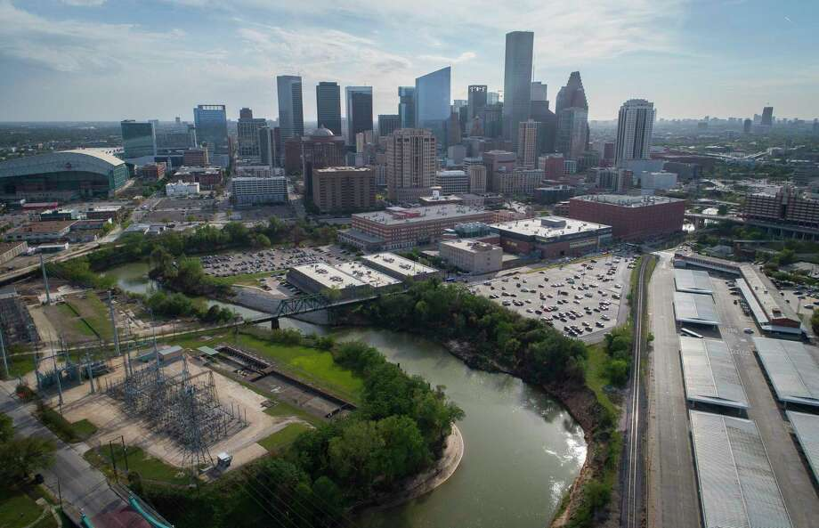 The Buffalo Bayou bends around the Harris County Jail after being joined by White Oak Bayou at Allen's Landing next to the University of Houston Downtown, in Houston. A proposed canal would cut across the area north of the jail and connect White Oak Bayou to Buffalo Bayou sooner, hopefully mitigating flooding risk upstream. Photo: Mark Mulligan, Houston Chronicle / Houston Chronicle / © 2018 Houston Chronicle