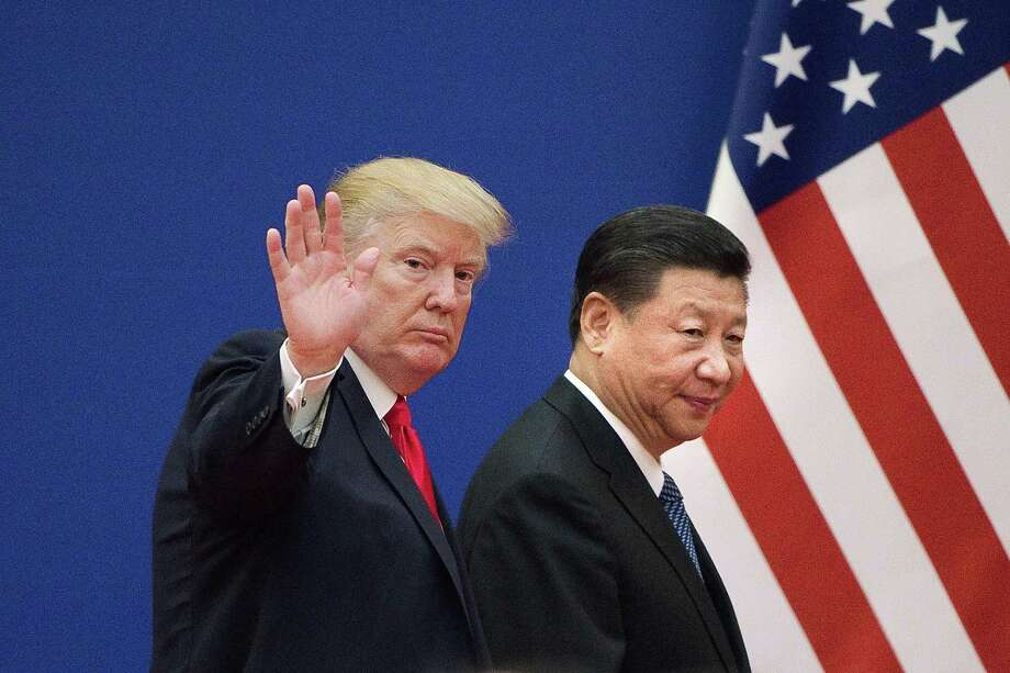 U.S. President Donald Trump, left, and China's President Xi Jinping leave a business leaders event at the Great Hall of the People in Beijing on Nov. 9, 2017. Photo: NICOLAS ASFOURI, Contributor / AFP/Getty Images / AFP or licensors