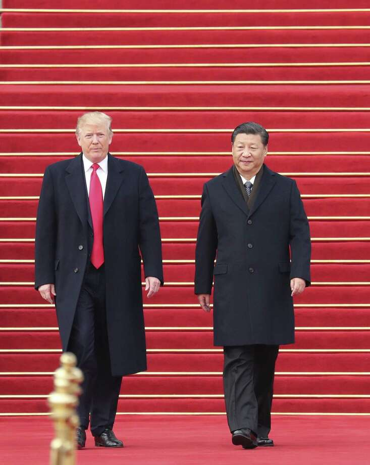Chinese President Xi Jinping, right, holds a grand ceremony to welcome U.S. President Donald Trump at the square outside the east gate of the Great Hall of the People in Beijing, capital of China, on Nov. 9, 2017. Photo: Xinhua, MBR / TNS / Sipa USA
