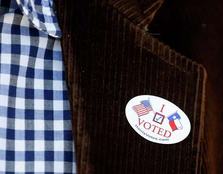 """A """"I voted"""" sticker on the lapel of a voter at Marshall Middle School, which was the Democratic polling place for Precinct 46, Tuesday, March 6, 2018, in Houston. ( Karen Warren / Houston Chronicle )"""