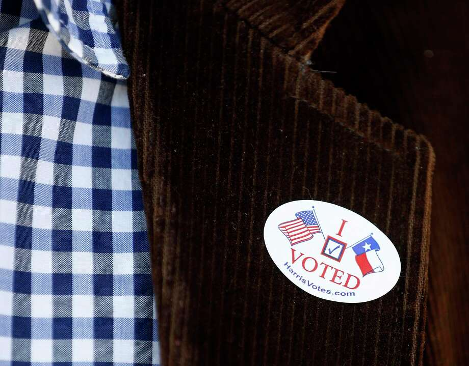 """A """"I voted"""" sticker on the lapel of a voter at Marshall Middle School, which was the Democratic polling place for Precinct 46, Tuesday, March 6, 2018, in Houston.  ( Karen Warren / Houston Chronicle ) Photo: Karen Warren, Staff / Houston Chronicle / © 2018 Houston Chronicle"""