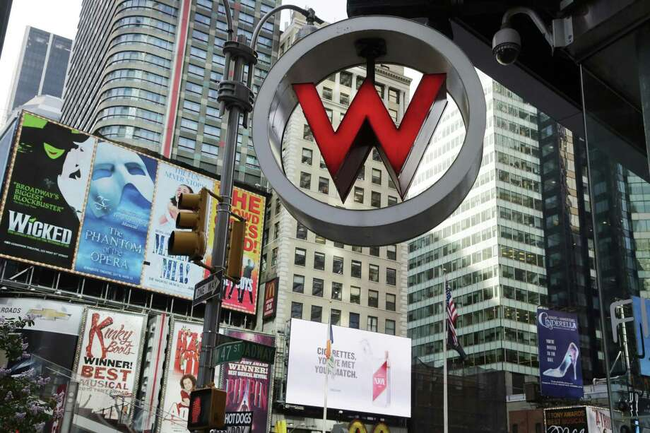 The logo for the W Hotel is seen in New York's Times Square in 2013. Photo: Mark Lennihan, STF / Associated Press / AP