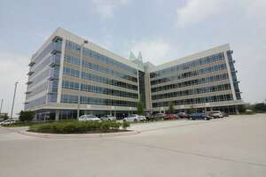 Cemex USA occupies two floors in its namesake building on the Katy Freeway. MetroNational developed and owns the building.