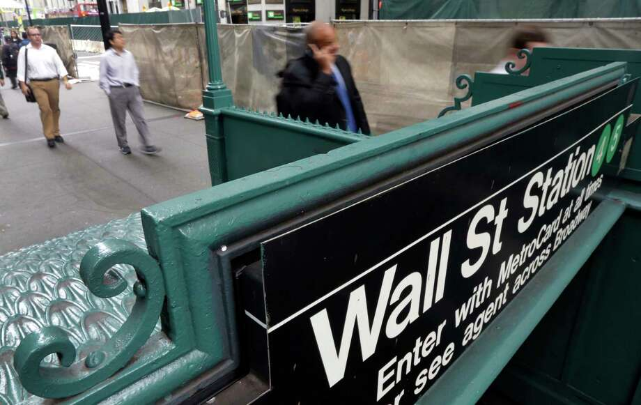 FILE- In this Oct. 2, 2014, file photo, the Wall Street subway stop on Broadway, in New York's Financial District. The U.S. stock market opens at 9:30 a.m. EDT on Wednesday, March 28, 2018. (AP Photo/Richard Drew, File) Photo: Richard Drew / Copyright 2016 The Associated Press. All rights reserved. This m