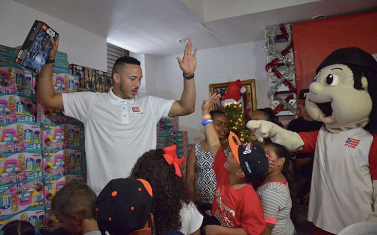 Astros shortstop Carlos Correa gives away toys and essentials at a charity event in Santa Isabel, P.R., two months after Hurricane Maria devastated his hometown