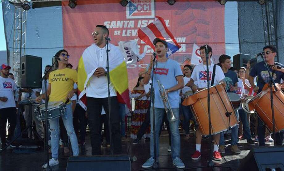 Astros shortstop Carlos Correa sings at a charity event in Santa Isabel, P.R., two months after Hurricane Maria devastated his hometown.  Photo: Russ Spielman / TLA