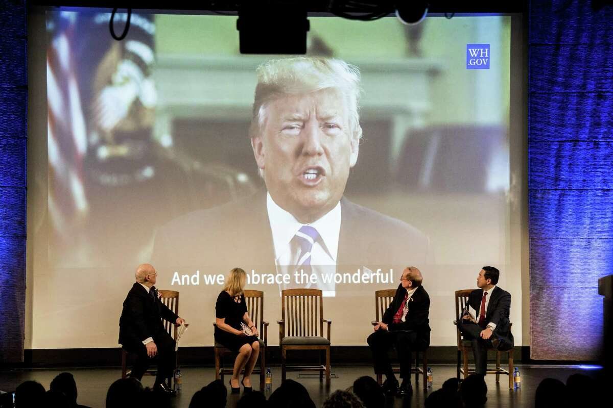 New citizens watch a video of President Donald Trump during a citizenship ceremony in New York, Sept. 18, 2017. The 2020 census will ask respondents if they are U.S. citizens, the Commerce Department announced Monday, March 27, 2018. Critics fear that the highly charged request by the Trump administration will result in a substantial undercount of the population because immigrants might not take part. (Devin Yalkin/The New York Times)