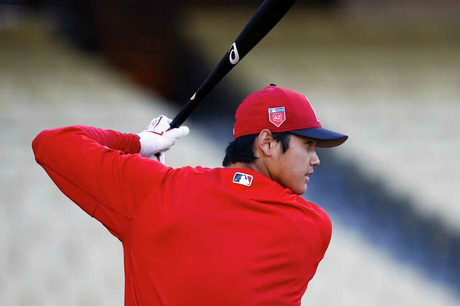 Los Angeles Angels starting pitcher Shohei Ohtani, of Japan, warms up before a preseason baseball game against the Los Angeles Dodgers, Tuesday, March 27, 2018, in Los Angeles. (AP Photo/Jae C. Hong) Photo: Jae C. Hong, Associated Press / Copyright 2018 The Associated Press. All rights reserved.