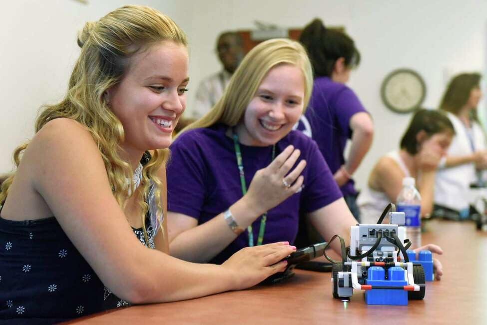Kaylee Petraccione, 17, of Schenectady, left, an alum of the summer camp, programs a robot with the help of GE intern Kelsey Harper during the 5th annual GE Girls summer STEM experience on Thursday, Aug. 11, 2016, at General Electric in Schenectady, N.Y. (Cindy Schultz / Times Union)