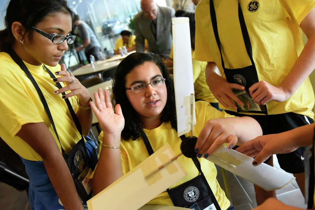 Kimberly Rampersaud, 13, left, and Liliana Soto, 12, center, join Oneida Middle School classmates as they build a wind turbine during the 5th annual GE Girls summer STEM experience on Thursday, Aug. 11, 2016, at General Electric in Schenectady, N.Y. (Cindy Schultz / Times Union)