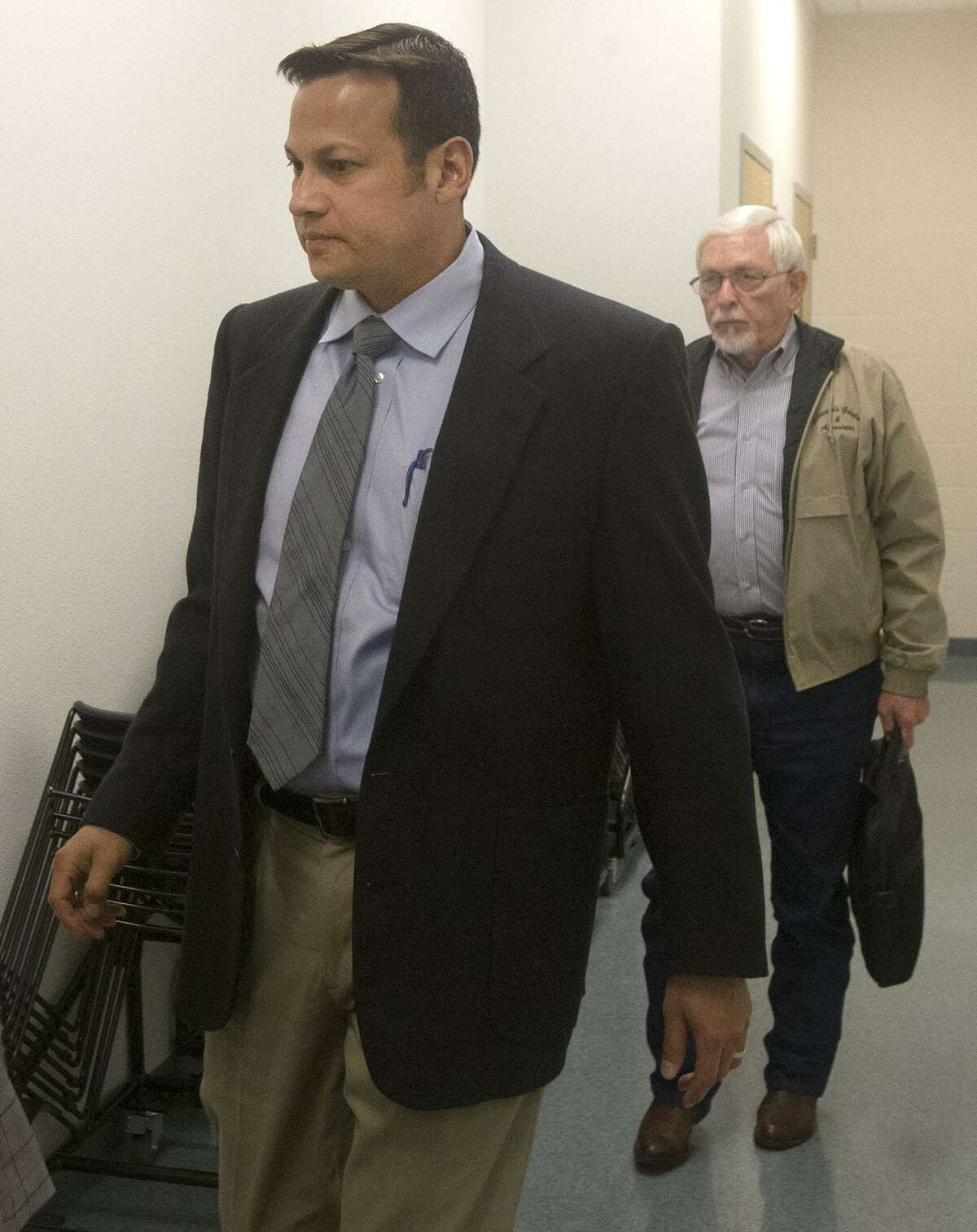 Former San Antonio attorney Mark Benavides (foreground) walks into court in Floresville in Wilson County on Wednesday. Benavides is accused of having sex with clients in exchange for legal services.