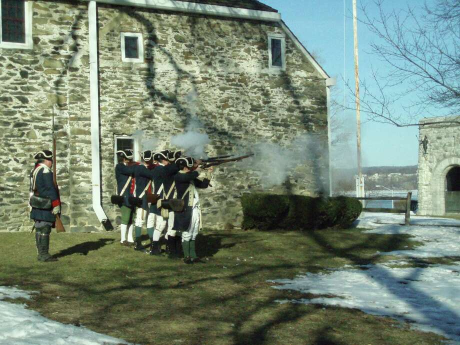 Reenactors firing muskets at Washington's Headquarters State Historic Site in Newburgh, NY. (Photo courtesy of New York State Office of Parks, Recreation and Historic Preservation; parks.ny.gov) Photo: New York State Office Of Parks, Recreation And Historic Preservation; Parks.ny.gov