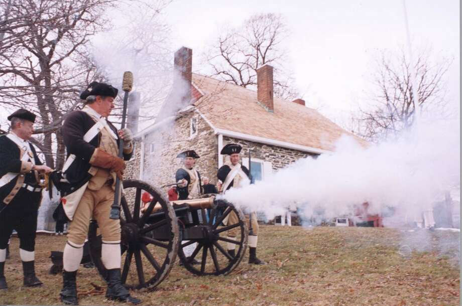 Reenactors firing a canon at Washington's Headquarters State Historic Site in Newburgh, NY. (Photo courtesy of New York State Office of Parks, Recreation and Historic Preservation; parks.ny.gov) Photo: New York State Office Of Parks, Recreation And Historic Preservation; Parks.ny.gov