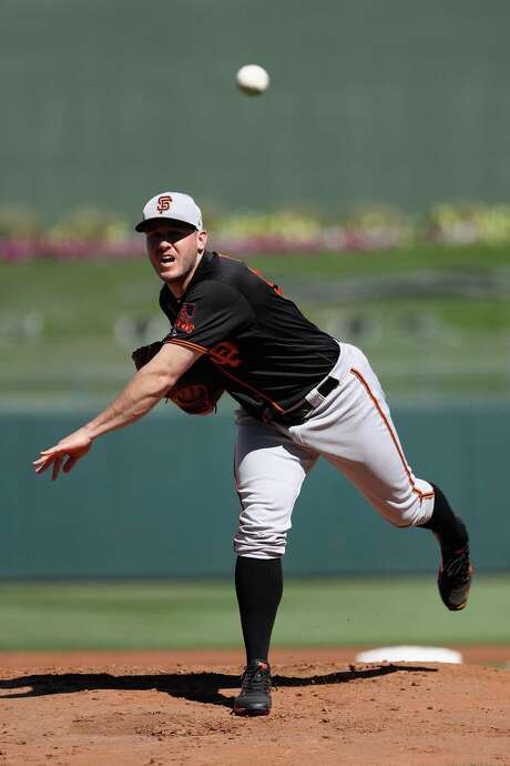 SURPRISE, AZ - MARCH 05:  Starting pitcher Ty Blach #50 of the San Francisco Giants throws a warm up pitch during the first inning of the spring training game against the Texas Rangers at Surprise Stadium on March 5, 2018 in Surprise, Arizona.  (Photo by Christian Petersen/Getty Images) Photo: Christian Petersen / Getty Images / 2018 Getty Images