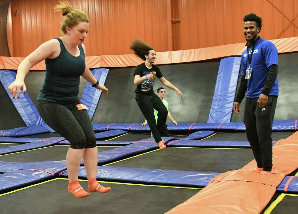 Leigh Hornbeck, left, takes a SkyFit class with instructor A.J. Burnett, right, at Sky Zone Trampoline Park on Wednesday, March 14, 2018 in Albany, N.Y. (Lori Van Buren/Times Union)
