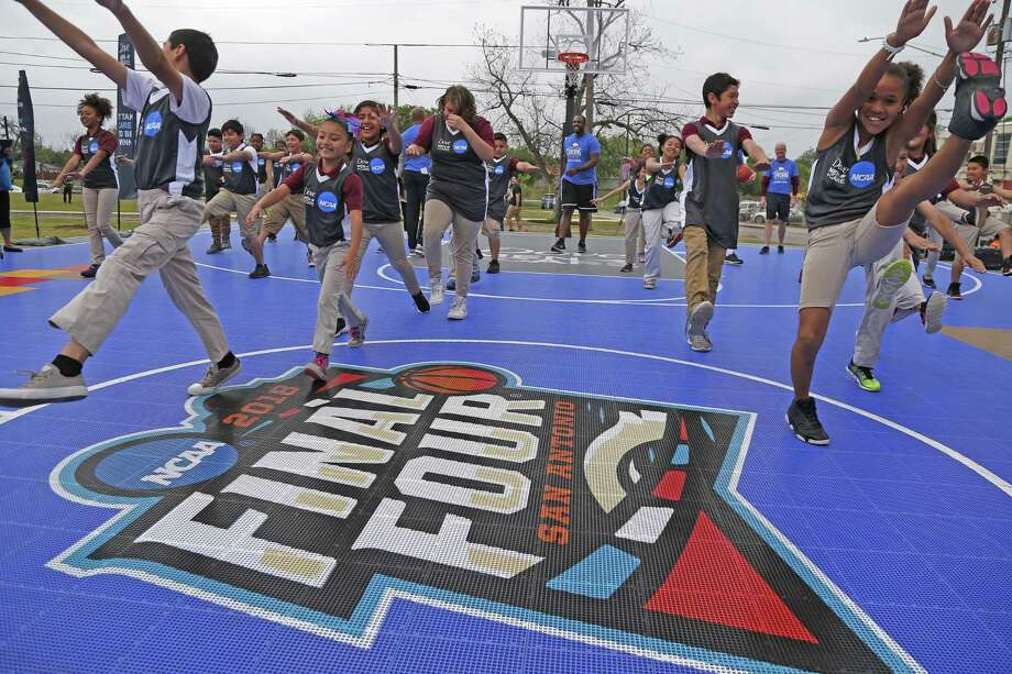 Kids from Higgs Carter King Gifted and Talented Academy go through agility drills Tuesday. Local basketball fans can help create an interactive, real-time mosaic at The Shops at Rivercenter by sharing their Final Four photos on social media. Photo: Ronald Cortes /For The San Antonio Express-News / 2018 Ronald Cortes