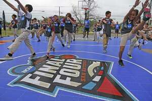 Kids from Higgs Carter King Gifted and Talented Academy go through agility drills Tuesday. Local basketball fans can help create an interactive, real-time mosaic at The Shops at Rivercenter by sharing their Final Four photos on social media.