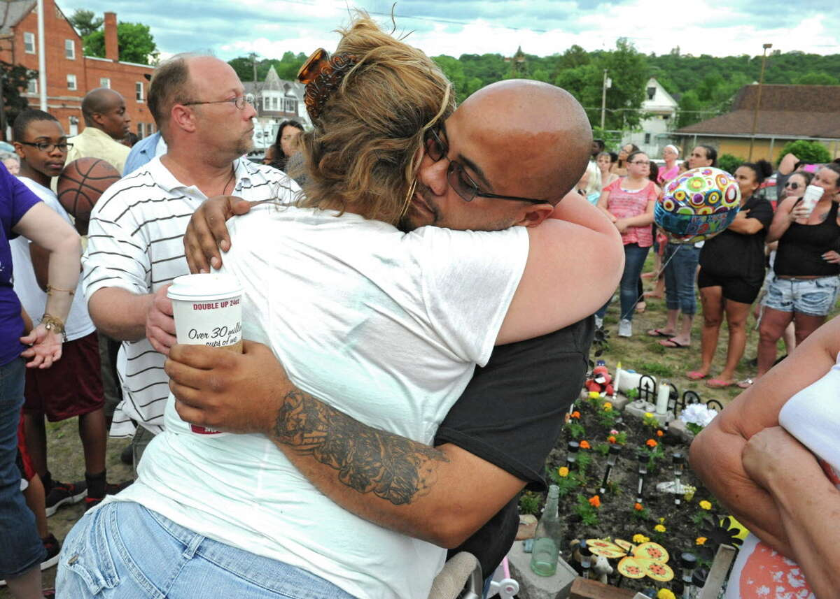 Vanessa Milligan's aunt Shannon Williamson hugs Vanessa's father Nate Milligan before balloons are released to remember Vanessa and daughter Alina at the site of Vanessa's apartment on Wednesday, June 1, 2016 in Troy, N.Y. A Rensselaer County Court jury Wednesday convicted Gabriel Vega of first-degree manslaughter and manslaughter in the killing of his pregnant ex-girlfriend and torching of her apartment. (Lori Van Buren / Times Union)