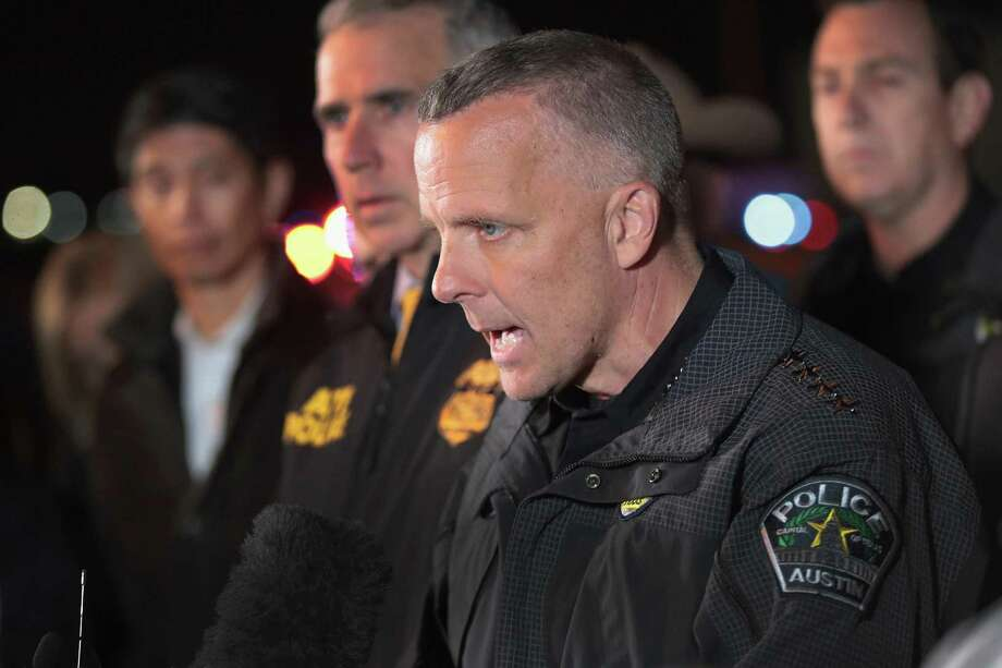 Austin Police Chief Brian Manley speaks to the media near the location where the suspected package bomber was killed in suburban Austin on March 21 in Round Rock. On Saturday, Manley refused to classify either of Mark Anthony Conditt's roommates as a suspect. Nor did he say that either has been cleared of any potential charges. Photo: Scott Olson /Getty Images / 2018 Getty Images