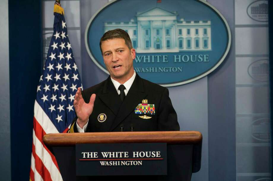 FILE-- Dr. Ronny Jackson, the White House physician, discusses President Donald TrumpOs health at the White House in Washington, Jan. 16, 2018. After weeks of uncertainty atop the Department of Veterans Affairs, President Trump on Wednesday said he plans to replace its secretary, David Shulkin, with Jackson, the presidentOs personal physician who is a rear admiral in the Navy. (Doug Mills/The New York Times) Photo: DOUG MILLS / NYTNS