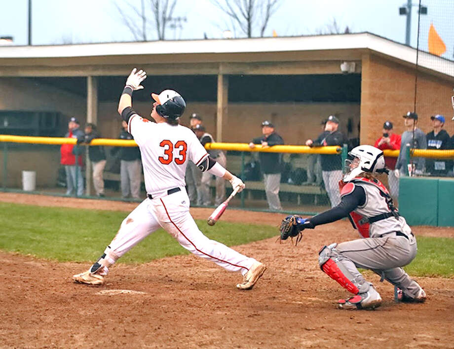 Edwardsville sophomore Drake Westcott follows through on his swing as he hits a walk-off grand slam in the bottom of the seventh to give the Tigers a win over Granite City Wednesday at Tom Pile Field.