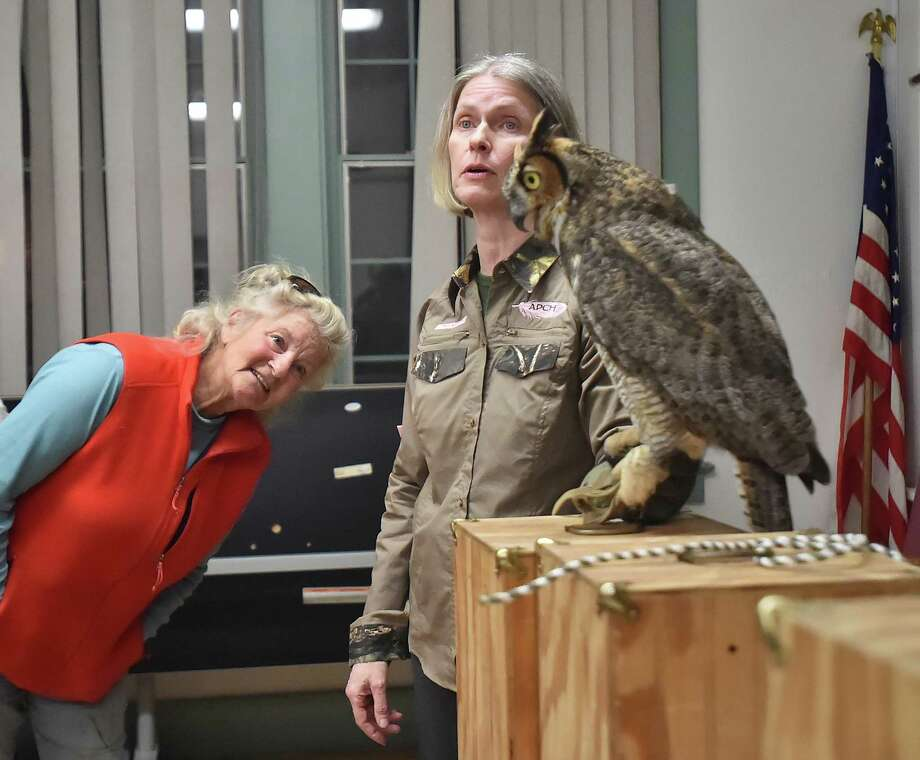 Christine Cummings, owner of A Place Called Hope, a rehabilitation and education center for birds of prey in Killingworth, and veteran volunteer rehabilitator Grace Krick, presented an educational evening about owls, Tuesday, March 27, 2018, at the Canoe Brook Senior Center at 11 Cherry Hill Road in Branford. The event, hosted by the Branford Land Trust is part of the Land Trust's year-long 50th anniversary celebration. Photo: Catherine Avalone, Hearst Connecticut Media / New Haven Register