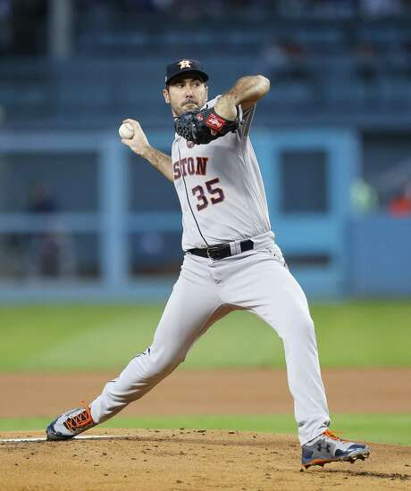 Astros ace Justin Verlander will become the 18th pitcher in major league history to make as many as 10 open-ing-day starts when he takes the mound this afternoon at Globe Life Park in Arlington. Photo: Brett Coomer, Houston Chronicle / Houston Chronicle / © 2017 Houston Chronicle
