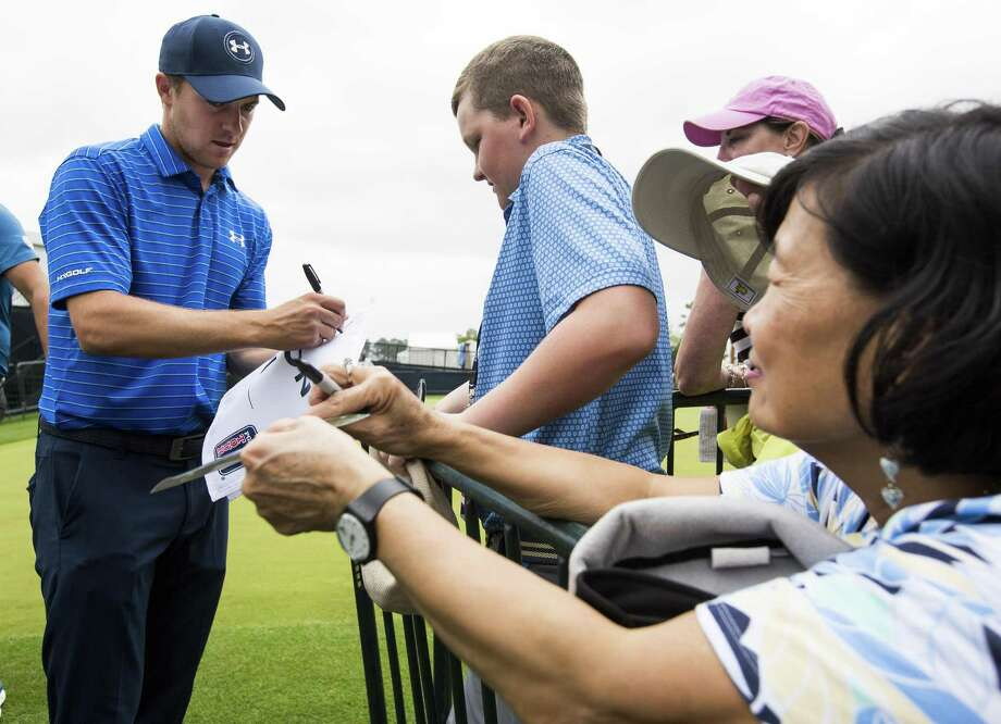 Jordan Spieth, left, signs autographs before Wednesday's Houston Open Grand Pro-Am at the Golf Club of Houston. Photo: Brett Coomer, Staff / Houston Chronicle / © 2018 Houston Chronicle