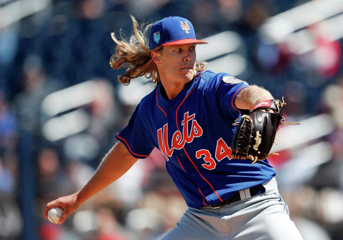 New York Mets starting pitcher Noah Syndergaard (34) works in the second inning of a spring training baseball game against the Washington Nationals Thursday, March 8, 2018, in West Palm Beach, Fla. (AP Photo/John Bazemore)