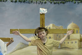 Aidan Voepel portrays Jesus during the passion play performed by St. Anthony Catholic School 3rd, 4th and 5th graders Wednesday. The play recounts the passion of Christ leading up to his crucifixion and resurrection, and is a traditional performance in many churches leading up to the Holy Day of Easter. Photo taken Wednesday, March 28, 2018 Kim Brent/The Enterprise