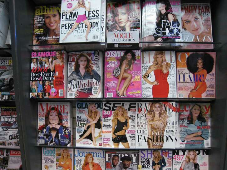 Magazines, including Cosmopolitan, at center, on a shelf at a newsstand in New York. Walmart said in a statement it had decided to remove the magazine from its checkout aisle displays in its 5,000-plus stores in the United States.