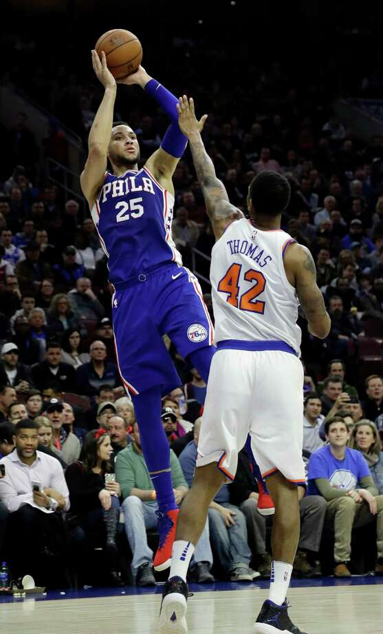 Philadelphia 76ers' Ben Simmons, left, goes up for a shot against New York Knicks' Lance Thomas during the second half of an NBA basketball game, Wednesday, March 28, 2018, in Philadelphia. Philadelphia won 118-101. (AP Photo/Matt Slocum) Photo: Matt Slocum / Copyright 2018 The Associated Press. All rights reserved