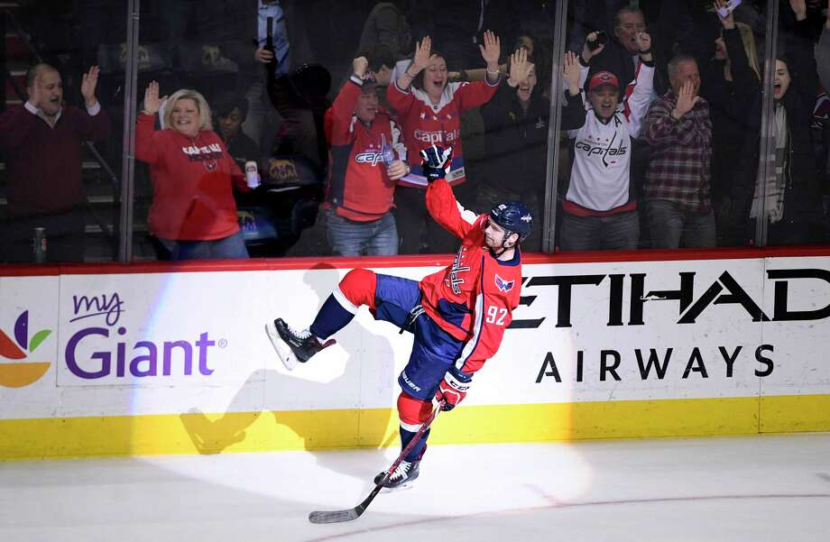 Washington Capitals center Evgeny Kuznetsov, of Russia, celebrates his game-winning goal in overtime of an NHL hockey game against the New York Rangers, Wednesday, March 28, 2018, in Washington. The Capitals won 3-2. (AP Photo/Nick Wass) Photo: Nick Wass / FR67404 AP