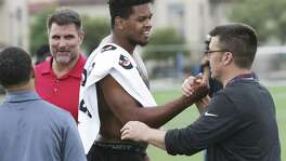 Marcus Davenport is congratulated by NFL scouts and coaches after he goes through drills for NFL scouts during the UTSA Pro Day at the school on March 28, 2018.