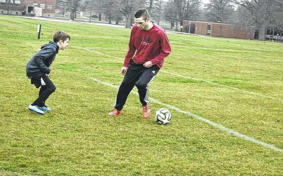 Jack Hudson (left) and John Gibbons work on soccer techniques Wednesday at Community Park.