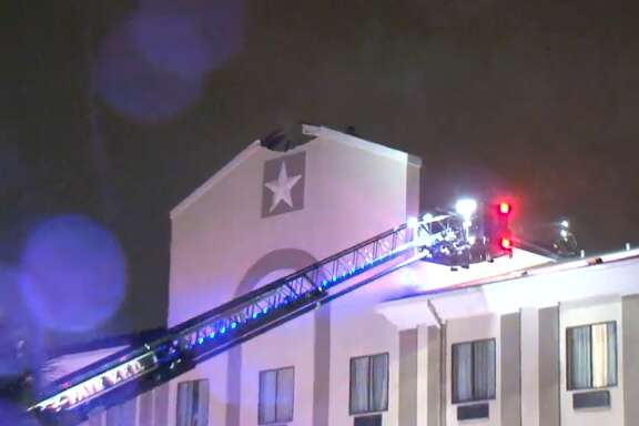A Holiday Inn Express & Suites caught fire after what is believed to be a lightning strike, Thursday, March 29, 2018.